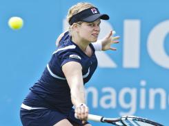 Kim Clijsters of Belgium slices a backhand during her victory Thursday against Francesca Schiavone of Italy.