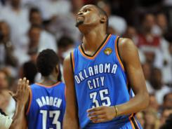Thunder forward Kevin Durant shows his disappointment in Game 5 of the NBA Finals, which his team lost to the Heat.