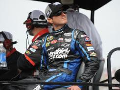 Kasey Kahne watches from teammate Jeff Gordon's pit during the April 1 race at Martinsville Speedway. Kahne crashed out midway through the race.