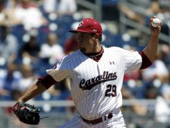 South Carolina pitcher Michael Roth threw a complete-game two-hitter and retired the last 22 batters as the Gamecocks beat Kent State 4-1 at the College World Series.