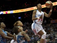 Atlanta Dream guard Angel McCoughtry (right) scores past Minnesota Lynx guard Seimone Augustus during the first quarter of game three of the WNBA Finals at Philips Arena on Oct. 7, 2011.
