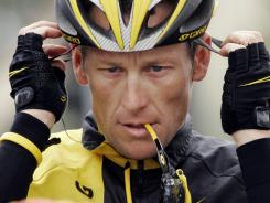 In this Feb. 22, 2009, file photo, Lance Armstrong prepares for the final stage of the Tour of California in Rancho Bernardo, Calif. The U.S. Anti-Doping Agency is bringing doping charges against the seven-time Tour de France winner.