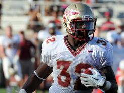 Florida State running back James Wilder Jr. runs the ball during the second half of the Florida State spring game.