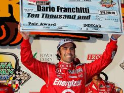 Dario Franchitti celebrates after earning the pole for Saturday night's Iowa Corn Indy 250. IndyCar introduced heat races Friday night for qualifying spots rather than the traditional single-car, two-lap structure.