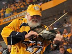 Country singer Charlie Daniels (shown performing at a Nashville Predators playoff game) tweeted congratulations and a photo of himself and Dale Earnhardt to celebrate Dale Earnhardt Jr.'s win.
