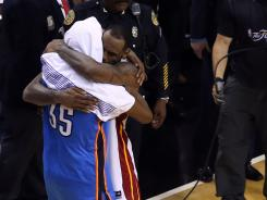 Oklahoma City Thunder forward Kevin Durant, left, and Miami Heat forward LeBron James, right, hug in the aftermath of the Heat's NBA championship victory Thursday. The two will likely become Olympic starters in July at London.
