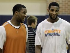 Thomas Robinson, left, talks with Andre Drummond at a Bobcats draft workout on Friday.