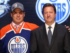 Neil Yakupov, first overall pick by the Edmonton Oilers, poses onstage with Oilers GM Steve Tambellini.