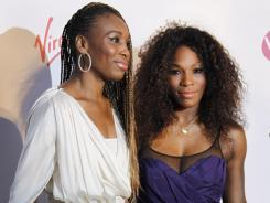 Venus and Serena Williams, arriving at the players party Thursday, have entered the doubles draw for Wimbledon.
