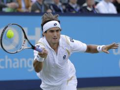 David Ferrer of Spain chases down a forehand during his victory Saturday against Philipp Petzschner of Germany in the final of the Unicef Open.