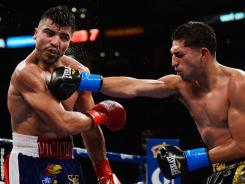 Josesito Lopez lands a right punch to the jaw of Victor Ortiz during the 12-round fight for the vacant WBC Silver Welterweight Championship at Staples Center in Los Angeles. Lopez won by TKO after breaking the jaw of Ortiz.