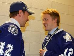 Defensemen Slater Koekkoek (left), taken 10th overall, and Morgan Rielly, taken fifth overall, talk during the first round of the draft.