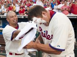 Shane Victorino gets Jim Thome with a shaving cream pie after Thome's walk-off homer in the bottom of the ninth off of Rays pitcher Jake McGee.