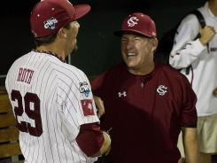 South Carolina coach Ray Tanner, right, and ace pitcher Michael Roth, who threw a two-hit shutout Thursday, will face Arizona in a best-of-three final beginning Sunday.