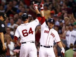 Will Middlebrooks, left, celebrates his home run with teammate Cody Ross. Middlebrooks played third base rather than regular starter Kevin Youkilis for the third consecutive game.