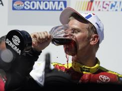 Clint Bowyer sips some celebratory wine Sunday in victory lane after his first career road-course victory, which happened to occur in Wine Country.