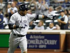 Yankees second baseman Robinson Cano celebrates after hitting a solo home run. It was his 16th homer of the year.