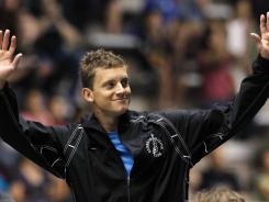 Chris Colwill waves during an awards ceremony after winning the men's 3-meter springboard final at the U.S. Olympic diving trials on Sunday.
