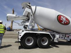 A worker walks by a cement truck during construction of the new San Francisco 49ers NFL football stadium in Santa Clara, Calif., Monday, May 21, 2012.