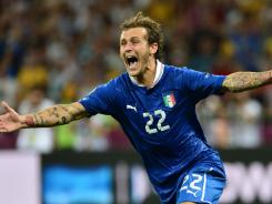 Alessandro Diamanti celebrates after scoring for Italy during the shootout of Sunday's quarterfinal match against England.
