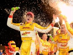 Ryan Hunter-Reay enjoys a late-night victory celebration at Iowa Speedway. The Andretti Autosport driver is three points behind Will Power for the series lead.