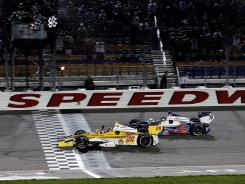 Ryan Hunter-Reay takes the checkered flag, winning the Iow Corn Indy 250 at Iowa Speedway in Newton, his second consecutive victory on the circuit.