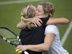 Maria Sharapova embraces Kim Clijsters during a practice session on the eve of the start of Wimbledon. This will be Clijsters' final appearance at Wimbledon.