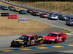 Kurt Busch (unsponsored red car) stalks eventual winner Clint Bowyer in the closing laps of Sunday's race at Sonoma. Busch finished third.
