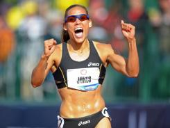 Lolo Jones celebrates after placing third in the women's 100-meter hurdles final, securing a berth for her second consecutive U.S. Olympic team.