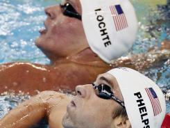 Michael Phelps and Ryan Lochte could meet Monday in the 400 IM final at the U.S. Olympic swimming trials in Omaha. In this July 25, 2011, file photo, Phelps and Lochte look at the scoreboard after their races in a heat of the men's 200 freestyle at the FINA Swimming World Championships in Shanghai.