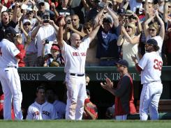 Kevin Youkilis waves to the crowd during the seventh inning before being traded to the White Sox.