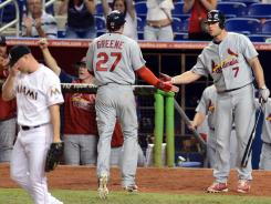 Tyler Greene scored on a double by St. Louis Cardinals shortstop Rafael Furcal in the 10th inning against the Miami Marlins.