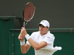 John Isner of the USA exited Wimbledon in the first round Monday with a five-set loss to Alejandro Falla of Colombia.