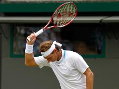 David Nalbandian of Argentina shows his frustration during his first-round, straight-sets loss to Janko Tipsarevic of Serbia.