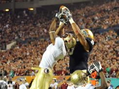 Notre Dame wide receiver Michael Floyd makes a touchdown catch in the second half of the Champs Sports Bowl at the Citrus Bowl last season.