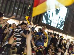 Fans of the German national team celebrate in Berlin after Germany beat Greece in the Euro 2012 quarterfinal match.