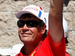 Michael Waltrip celebrates in victory lane at Sonoma after Clint Bowyer held off Tony Stewart and Kurt Busch for his team's first win in two years and third in six seasons overall.