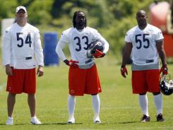 Chicago Bears players Brian Urlacher (54) , Charles Tillman (33) and Lance Briggs (55) during organized team activities May 23.