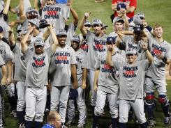 Arizona celebrates after defeating South Carolina to win the NCAA College World Series on Monday in Omaha.