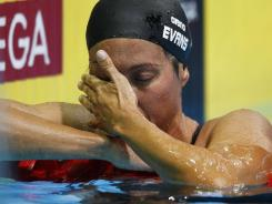 Janet Evans reacts after swimming in the women's 400 freestyle prelims Tuesday at the U.S. Olympic swimming trials in Omaha.