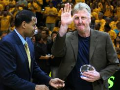 Indiana Pacers president Larry Bird, here accepting the NBA Executive of the Year Award from Stu Jackson on May 17, has decided not to return to the Pacers front office next season.