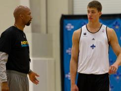 Illinois center Meyers Leonard, right, worked out with New Orleans Hornets coach Monty Williams ahead of Thursday's NBA draft.