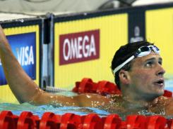 Ryan Lochte checks the leader board after competing in the preliminaries of the men's 200 freestyle at the U.S. Olympic swimming trials Tuesday in Omaha.
