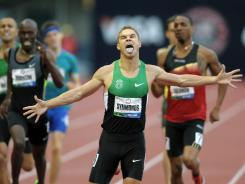 Nick Symmonds celebrates after defeating Khadevis Robinson (left) and Duane Solomon to win the 800m in 1:43.92 at the U.S. Olympic Team Trials.