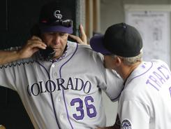 "Can't take it anymore: Saying he was ""fried,"" Rockies pitching coach Bob Apodaca, left, with manager Jim Tracy, resigned."