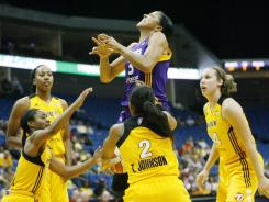 Sparks forward Candace Parker gets quadruple-teamed by the Shock, losing the ball while attempting to score during Tuesday's game.
