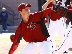 "D'Back debuts: Pitcher Trevor Bauer, warming up during spring training, is ""the gunslinger coming into town,"" UCLA coach John Savage says."