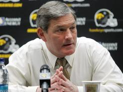 Iowa football coach Kirk Ferentz talks to reporters on Feb. 2, 2011 about the 13 players hospitalized with a muscle disorder caused by grueling workouts.