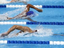 Phelps, bottom, beat Ryan Lochte to win the 200-meter freestyle final in the U.S. Olympic trials.