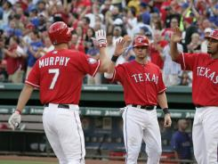 David Murphy went 4-for-5 with five RBI and scored three runs in the Rangers' 13-9 victory.